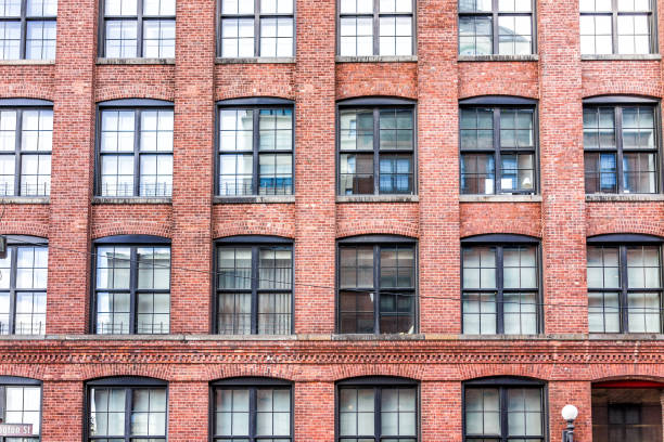 Pattern of brick glass window building in Brooklyn, NYC, New York City, front exterior grunge old architecture stock photo