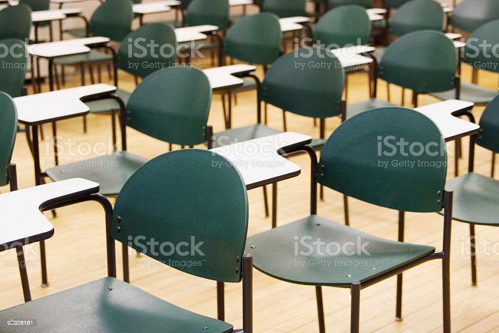 Pattern of chairs in a high school classrooom royalty-free stock photo