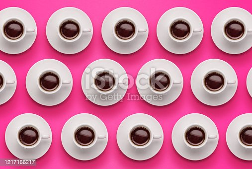 Pattern of coffee cups on vibrant pink background