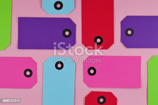 istock pattern of colorful labels on pink background 868242312
