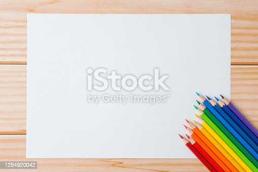 1137970382 istock photo Pattern of Colorful Many colored pencils and white paper on wooden background and copy space 1254920042
