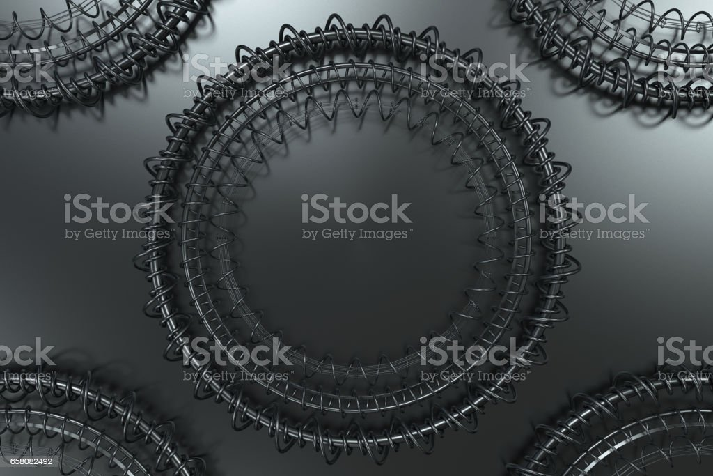 Pattern of concentric shapes made of rings and spirals on black background royalty-free stock photo