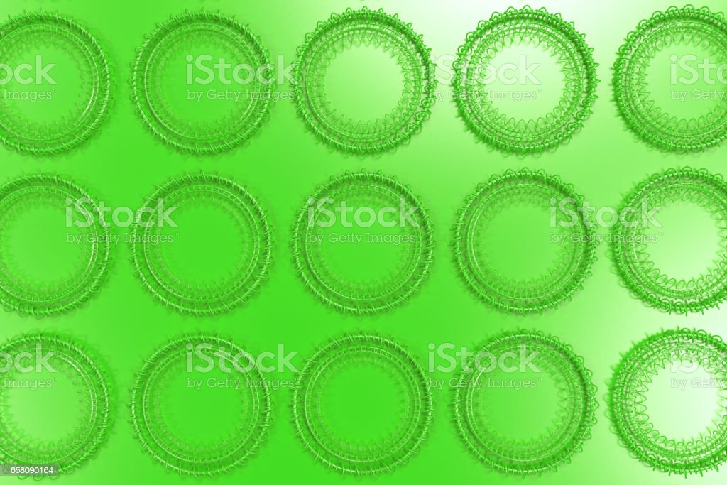 Pattern of concentric shapes made of rings and spirals on green background royalty-free stock photo
