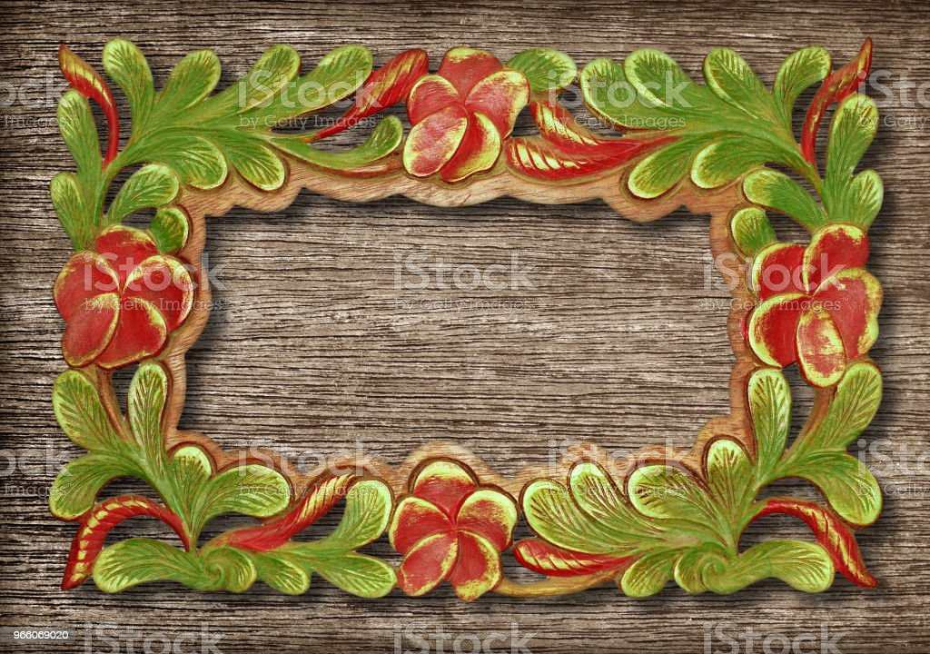 Pattern of flower carved frame on wood background - Royalty-free Antique Stock Photo