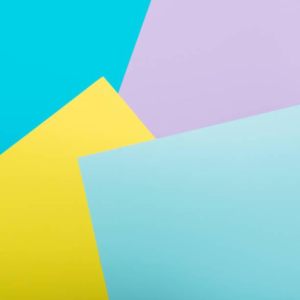Pattern of geometric yellow, blue and pink background. Minimalism stock photo