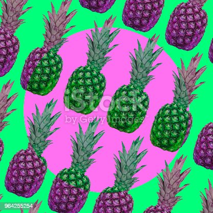 1014178170istockphoto A pattern of green and pink pineapples with a circle in the middle. 964255254