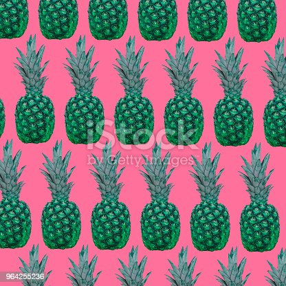 1014178170istockphoto A pattern of green pineapples on a pink background. 964255236