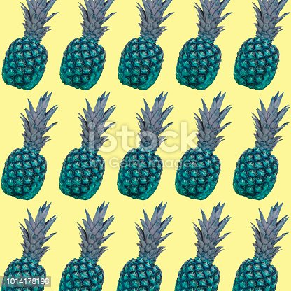 964258970 istock photo A pattern of green pineapples on a yellow background. 1014178196