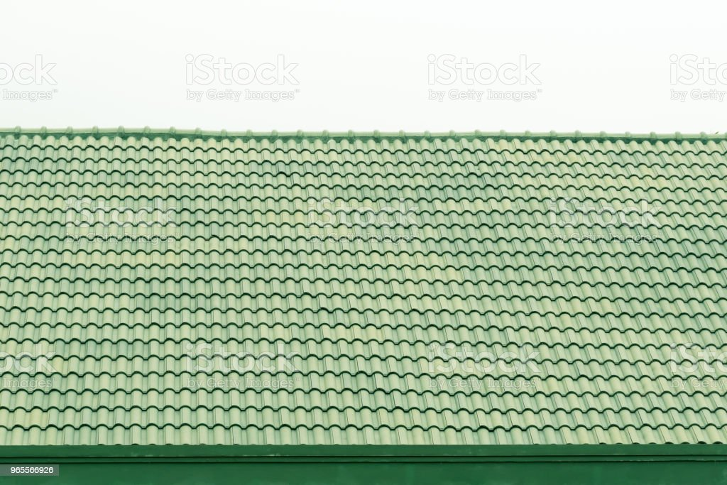 Pattern of green roof tiles, Architecture background.