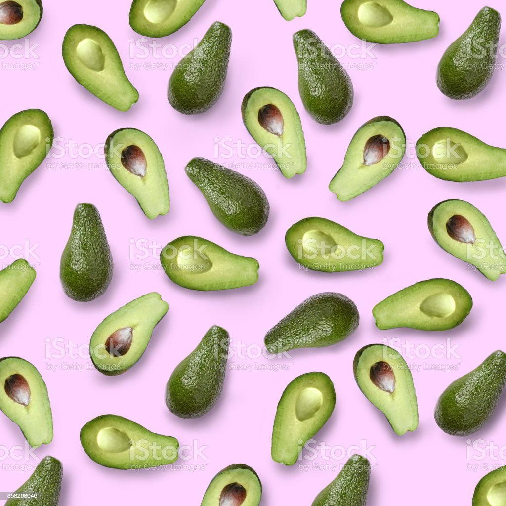 pattern of halves of avocado stock photo