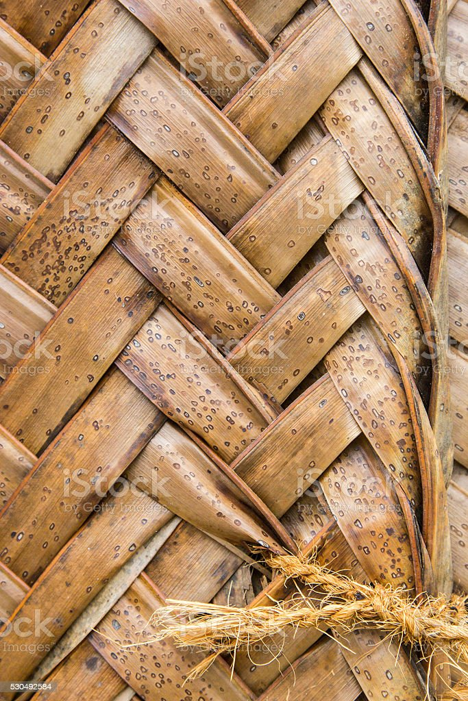Pattern of interweaving brown palm leaves stock photo