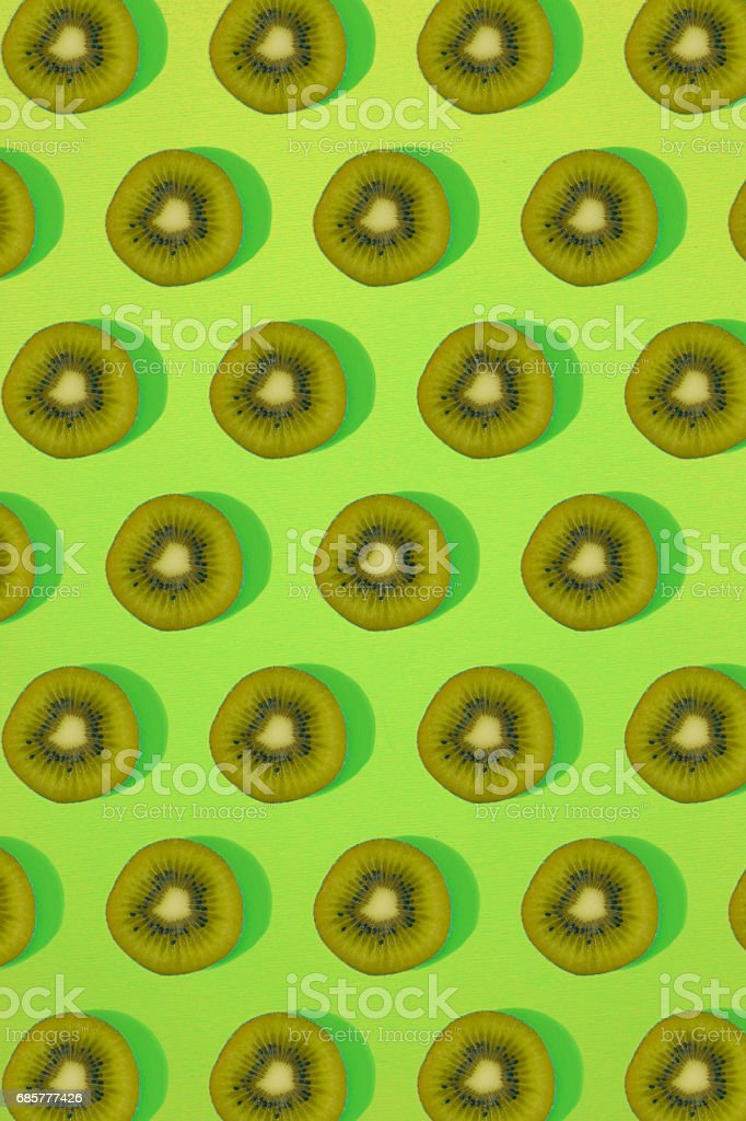 Pattern of kiwi. Top view of the sliced kiwi on green background. Minimal flat lay concept royalty-free stock photo