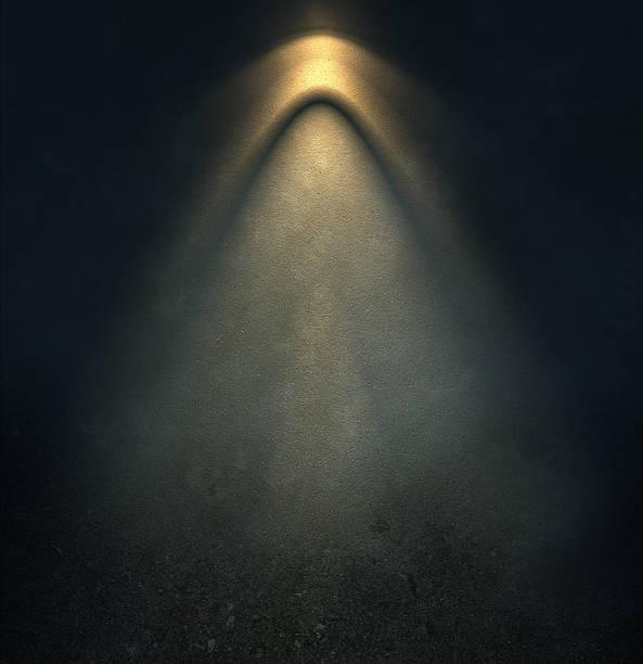 pattern of light on dark wall stock photo