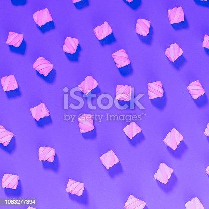 Pattern of marshmallow on purple background. Minimal flat lay