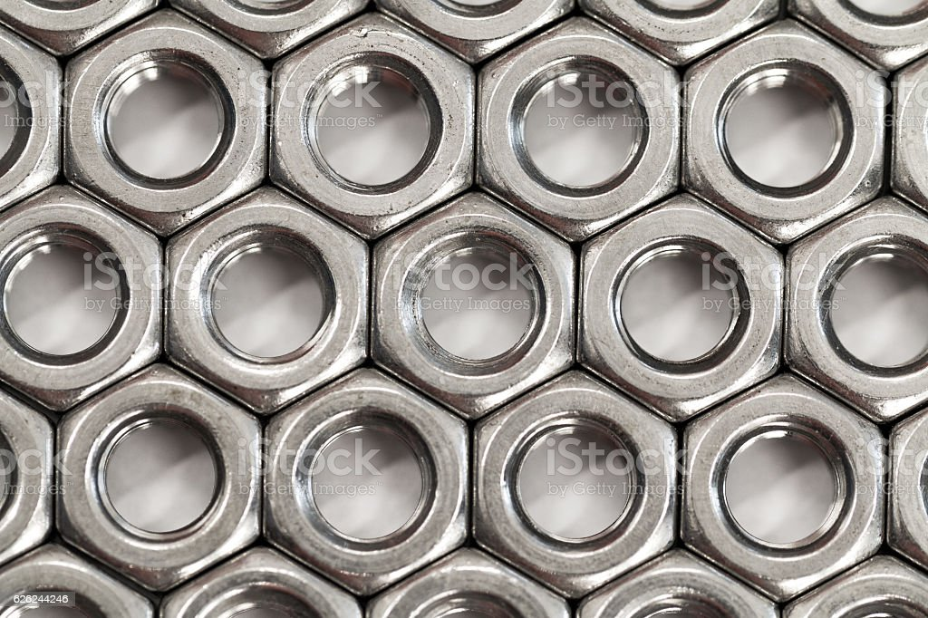 Pattern of nuts for the bolts stock photo