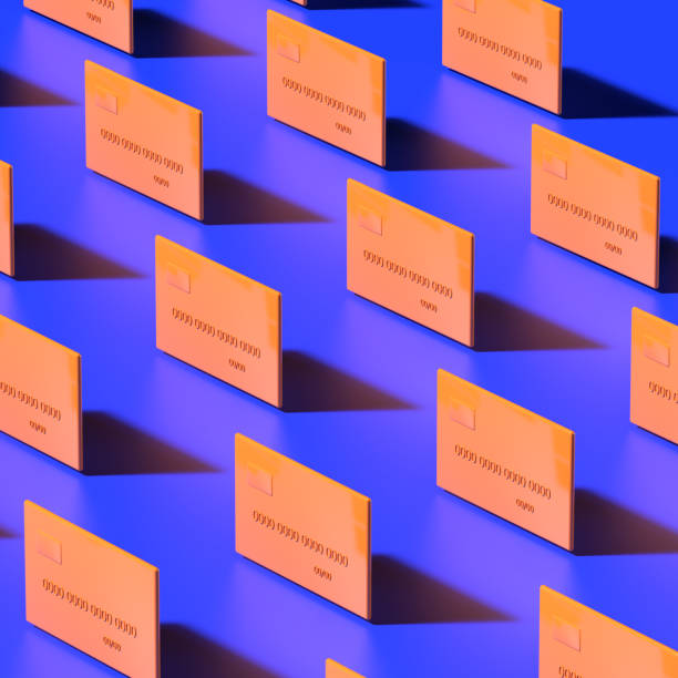 A pattern of orange credit cards is lined up on a dark blue background. 3D render.