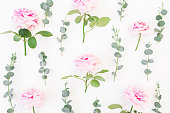 istock Pattern of pink flowers and eucalyptus branches on white background. Flat lay, top view. Valentine's background 839337678