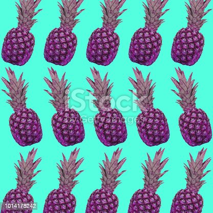 964258970 istock photo A pattern of pink pineapples on a blue background. 1014178242