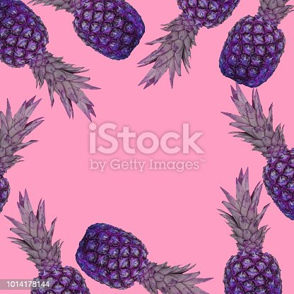 964258970 istock photo A pattern of purple pineapples on a pink background. 1014178144