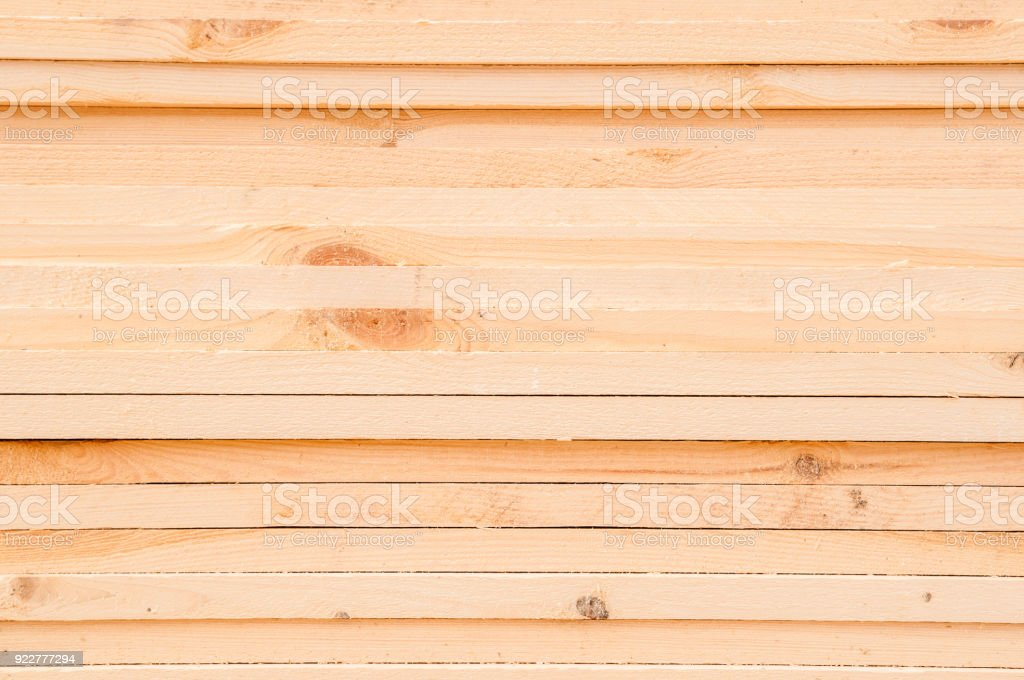 Pattern of stacked rectangular wooden beam timber at sawmill lumberyard stock photo