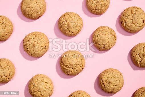 Pattern of sweet cookies on pink background. Top view. Flat lay.