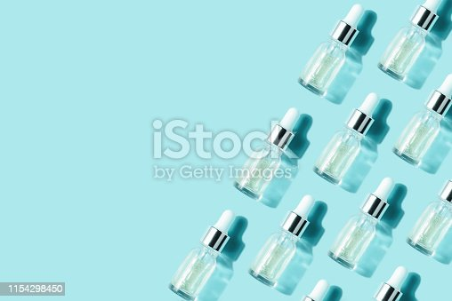 istock Pattern of their transparent bottles with cosmetic. Concept of injection is hyaluronic acid, botulin 1154298450