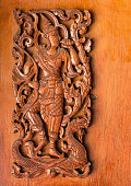 pattern of traditional thai style carved on wood background