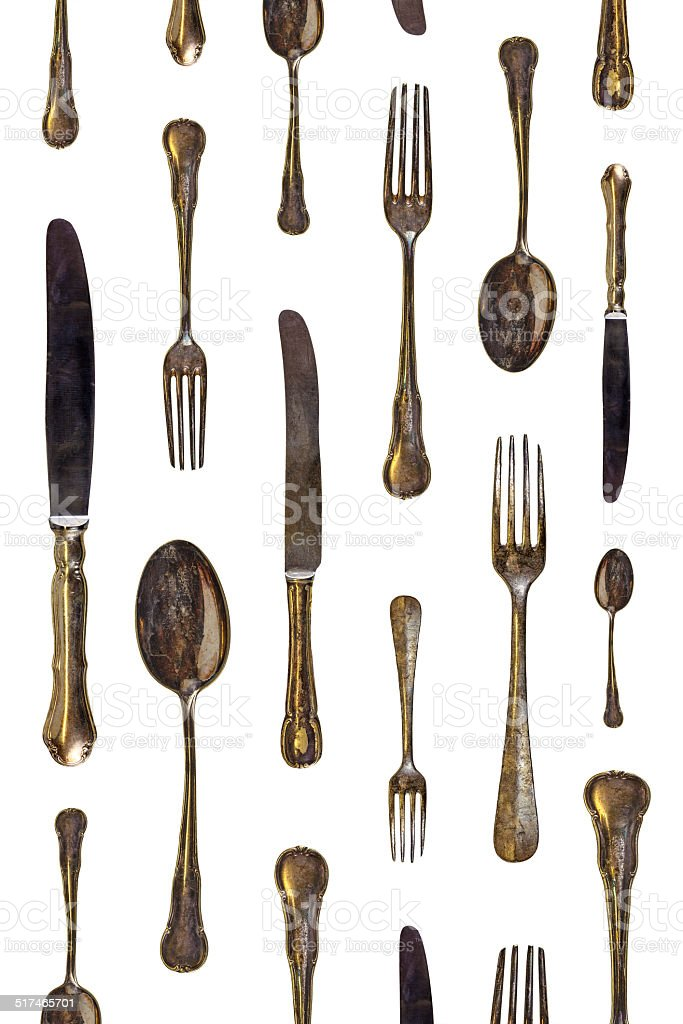 Pattern of vintage spoons, knives and forks stock photo