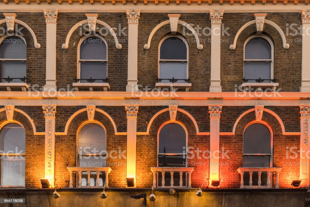 Pattern of windows in a british building stock photo