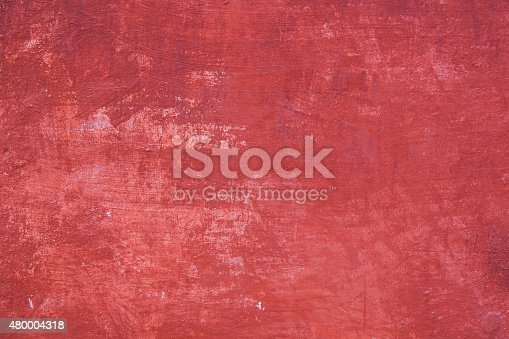 pattern on part of wall with plaster in different shades of red