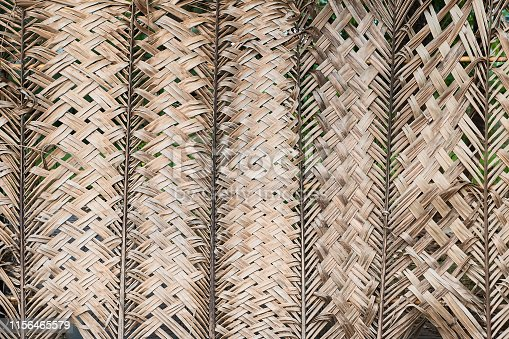 istock Pattern weaving of coconut leaves for background. 1156465579