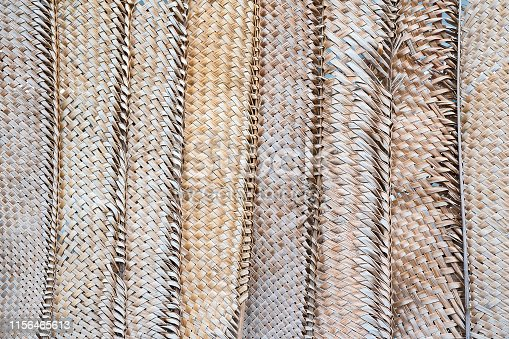 istock Pattern weaving of coconut leaves for background. 1156465613