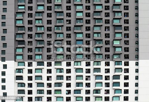 Pattern window building for design texture, Pattern modern building, condominium Isolated on white background, An isolated hightower, Many windows on a building