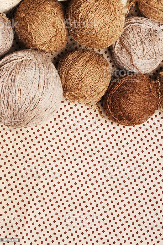 pattern with pile of brown yarn stock photo