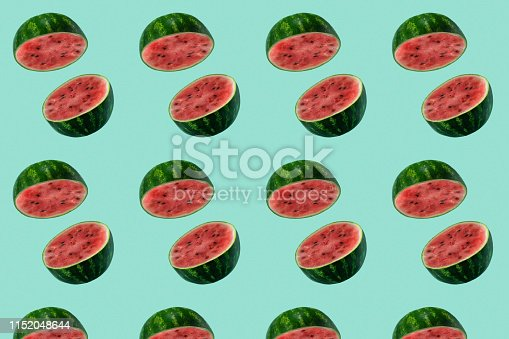 istock Pattern with watermelon sliced flying on pastel green background. Minimal fruit and summer concept. 1152048644