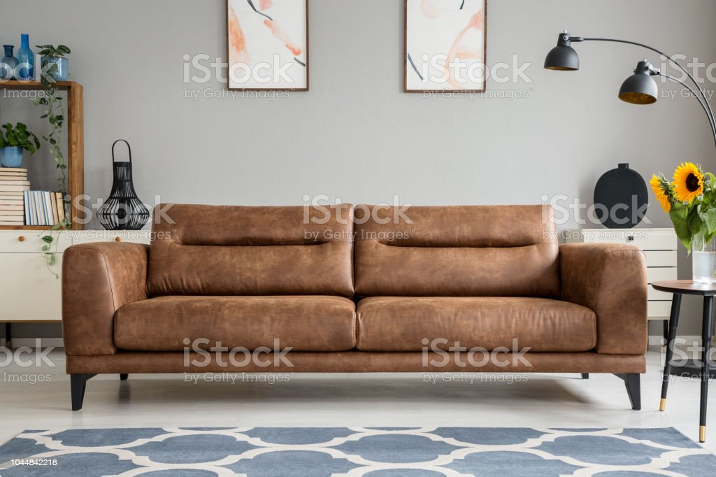 Patterned Blue Carpet In Front Of Brown Leather Sofa Grey Living Room Interior With Posters Real Photo Stock Download Image Now Istock