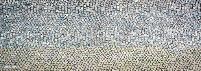 A background texture of cobbles in Paris, France.