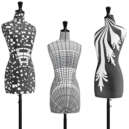 istock Patterned female mannequins in a black metal tripod, close view 497903890