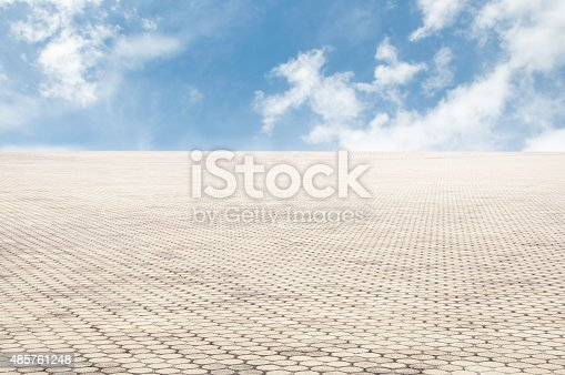 istock patterned paving tiles with blue sky background 485761248