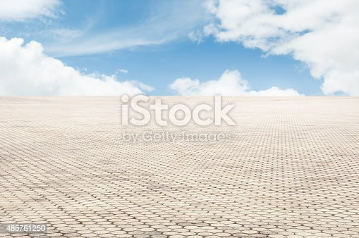 istock patterned paving tiles with blue sky background 485761250