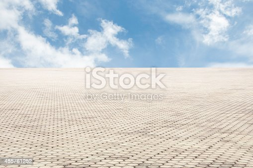 istock patterned paving tiles with blue sky background 485761252