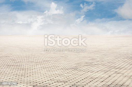 istock patterned paving tiles with blue sky background 485761260