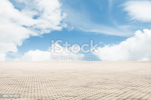 istock patterned paving tiles with blue sky background 485761262