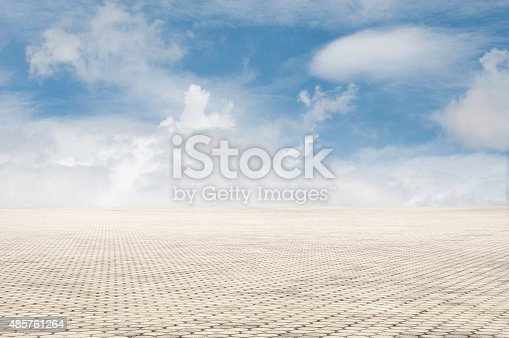 istock patterned paving tiles with blue sky background 485761264