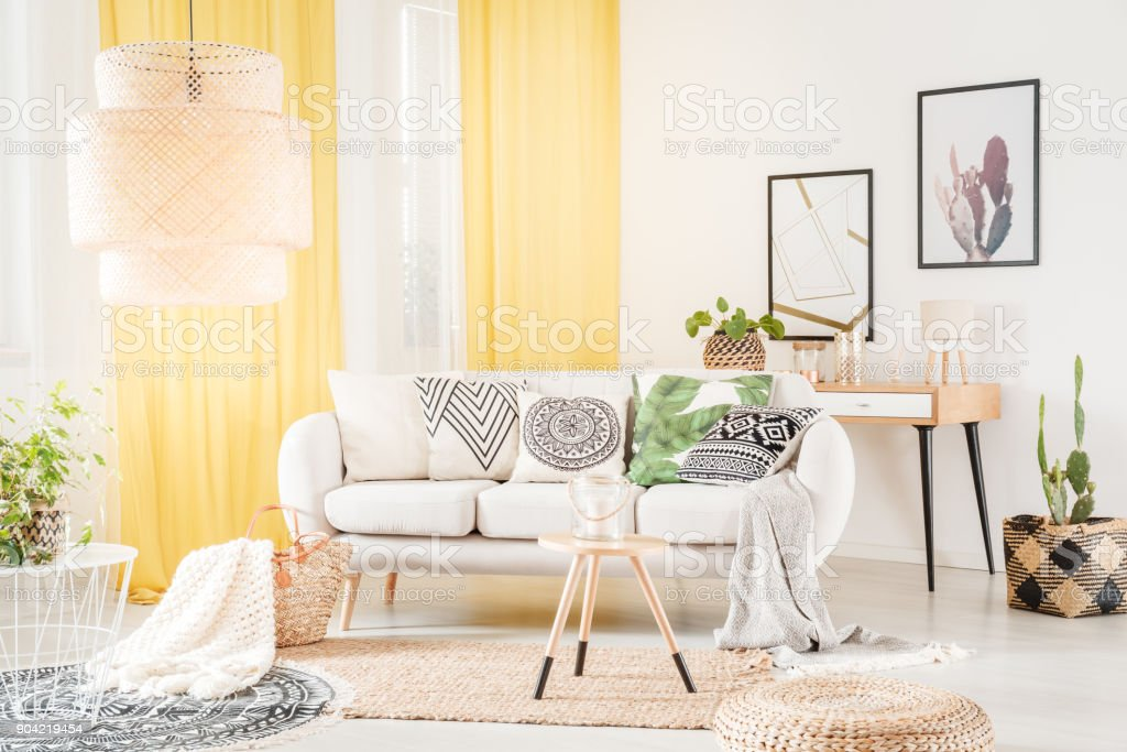 Patterned pillows lying on sofa stock photo