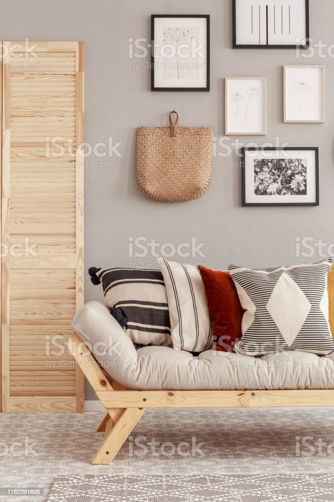 Wondrous Patterned Pillows On Comfortable Scandinavian Couch In Beige Dailytribune Chair Design For Home Dailytribuneorg