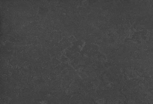 Patterned rubber tiles abstract background material floor dark gray black color
