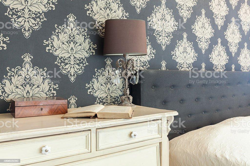 Patterned wallpaper in retro interior stock photo