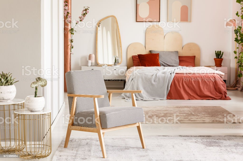 Patterned Wooden Armchair Next To Gold Table In Orange ...