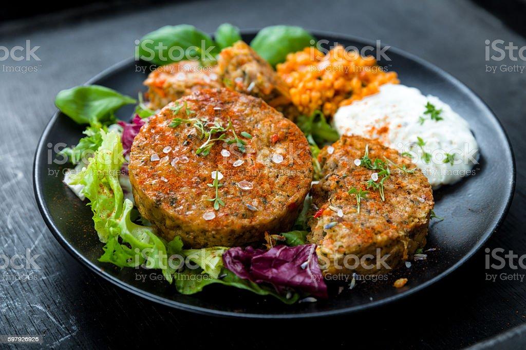 Patties on lettuce with bulgur stock photo